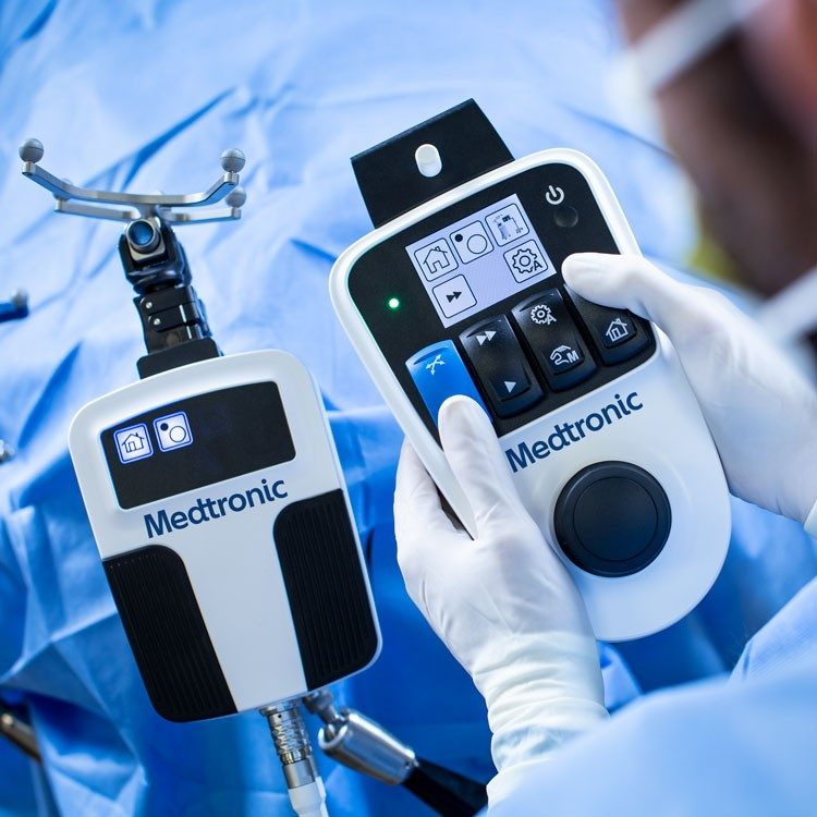 Surgeon uses the Stealth Autoguide cranial robotics guidance platform in the operating room.