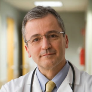 Male physician wearing a tie and stethoscope